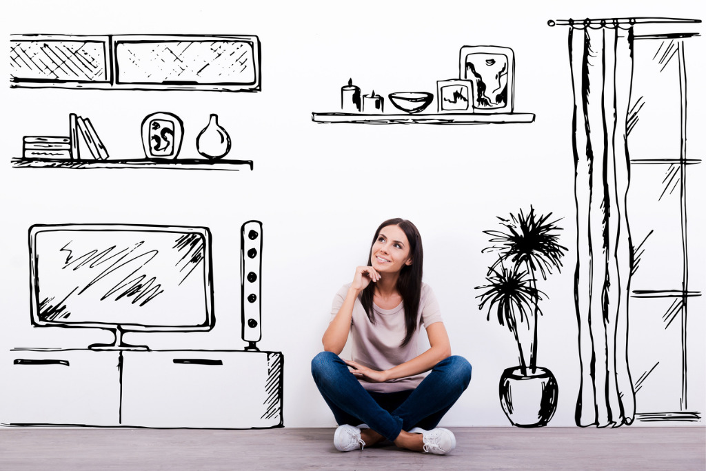 Woman in front of wallpaper with furniture